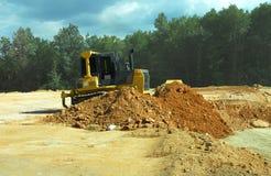 Escavadora resistente no trabalho Fotos de Stock Royalty Free