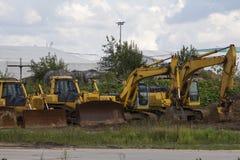 Escavadoras e máquinas escavadoras no local Fotografia de Stock