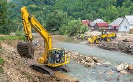 Escavatore al cantiere Immagini Stock Libere da Diritti