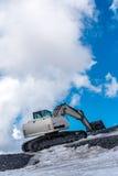 Escavatore che funziona nelle alte alpi Austria Fotografie Stock Libere da Diritti