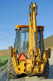 Escavatore a cucchiaia rovescia da dietro Fotografia Stock