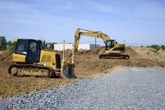 Escavatore a cucchiaia rovescia e bulldozer Fotografie Stock