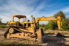 Escavatore del caricatore della ruota con l'escavatore a cucchiaia rovescia del trattore a cingoli Fotografie Stock Libere da Diritti