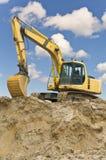 Escavatore del trattore a cingoli Immagini Stock