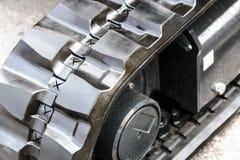 Escavatore del trattore a cingoli del metallo con i cuscinetti di gomma Fotografia Stock