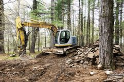 Escavatore dell'escavatore a cucchiaia rovescia al posto di lavoro Fotografia Stock Libera da Diritti