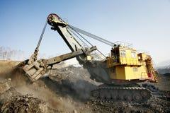 Escavatore della miniera sul lavoro Fotografia Stock