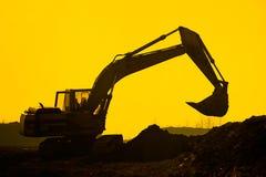 Escavatore della siluetta Fotografia Stock