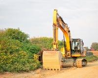 Escavatore giallo del cingolo Fotografie Stock Libere da Diritti