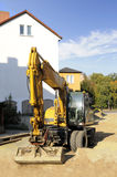 Escavatore giallo sul cantiere Fotografie Stock Libere da Diritti