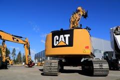 Escavatore idraulico del gatto 320E su un'iarda Fotografie Stock Libere da Diritti