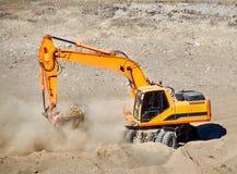 Escavatore nell'azione Immagine Stock Libera da Diritti