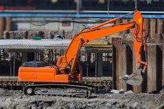 Escavatore su un cantiere Fotografie Stock Libere da Diritti