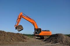 Escavatore sul lavoro Immagine Stock