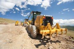 Escavatore, zappatore, scavatrice al cantiere fotografia stock