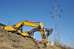 Escavatori che scavano sul luogo Immagine Stock Libera da Diritti