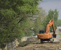 Escavatori del mucchio che scavano la terra Fotografie Stock Libere da Diritti