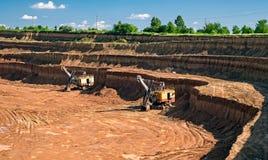 Escavatori della cava del caolino Immagini Stock