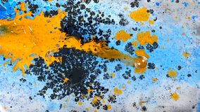Escena abstracta de la tinta amarilla, azul y negra metrajes