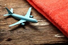 Escena azul del avión y de la toalla Imágenes de archivo libres de regalías