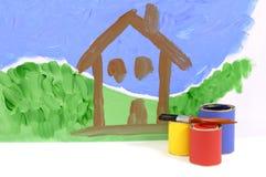 Escena de la casa en la pared pintada Fotos de archivo