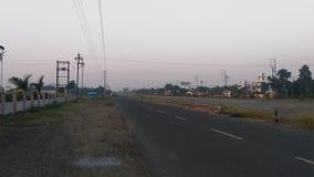 Escena de la madrugada de la carretera india imágenes de archivo libres de regalías