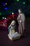 Escena de la natividad con las luces y las velas Imagenes de archivo
