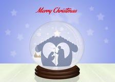 Escena de la natividad de la Navidad en la bola de cristal Imagen de archivo libre de regalías