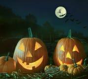 Escena de la noche con las calabazas y la luna de Halloween Imagenes de archivo