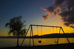 Escena de la playa de la puesta del sol Imagen de archivo libre de regalías