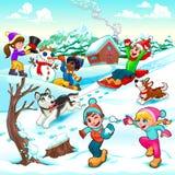 Escena divertida del invierno con los niños y los perros Imagen de archivo