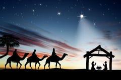 Escena tradicional de Christian Christmas Nativity con los tres wi Fotografía de archivo libre de regalías