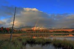 Escena y arco iris de la caída de Maine Imagenes de archivo