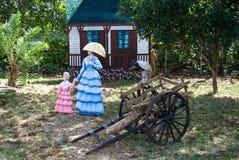 Esclave déchargeant un chariot Photos stock