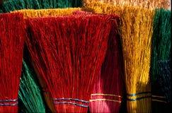 Escobas coloridas Imagenes de archivo