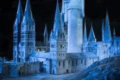 Escola de Hogwarts da feitiçaria e da feitiçaria, modelo contra do fundo preto Imagem de Stock Royalty Free