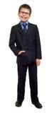Escolar en el traje y las lentes en blanco aislados, risa, concepto de la educación Imagen de archivo libre de regalías