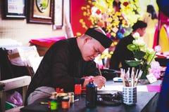 Escolar vietnamita del festival del año lunar Ésta es una tradición del Año Nuevo lunar vietnamita Imagen de archivo