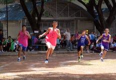 Escolares en raza corriente Imagen de archivo libre de regalías
