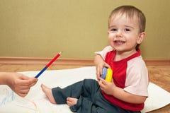 Escolha difícil para uma criança talentoso Fotografia de Stock Royalty Free
