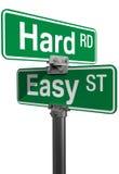 Escolha dura do sinal de rua fácil da estrada Fotos de Stock Royalty Free