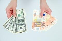 A escolha entre o euro e os dólares Fotografia de Stock