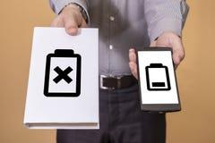 Escolha entre o livro e a vida da bateria do telefone celular Fotos de Stock Royalty Free
