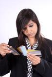 Escolhendo cartões de crédito Fotos de Stock