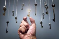 Escolhendo a chave ao sucesso Fotografia de Stock