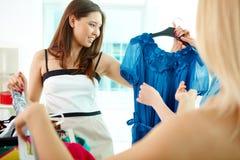 Escolhendo o vestido Imagem de Stock Royalty Free