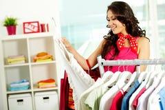 Escolhendo o vestido novo Imagem de Stock Royalty Free