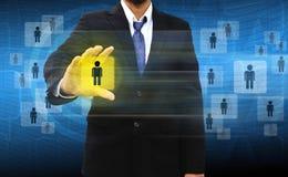 Escolhendo a pessoa adequada em executivos do grupo Imagens de Stock