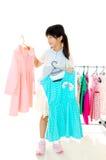 Escolhendo a roupa Imagens de Stock Royalty Free