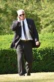 Escolta mayor serio Wearing Sunglasses Walking fotos de archivo